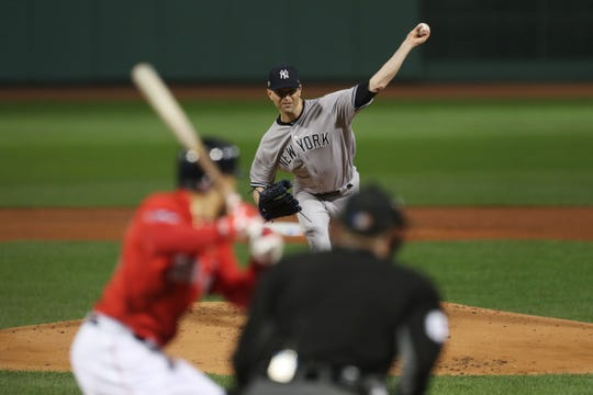 Oct 5, 2018; Boston, MA, USA; New York Yankees starting pitcher J.A. Happ (34) throws the ball during the first inning against the Boston Red Sox in game one of the ALDS at Fenway Park.
