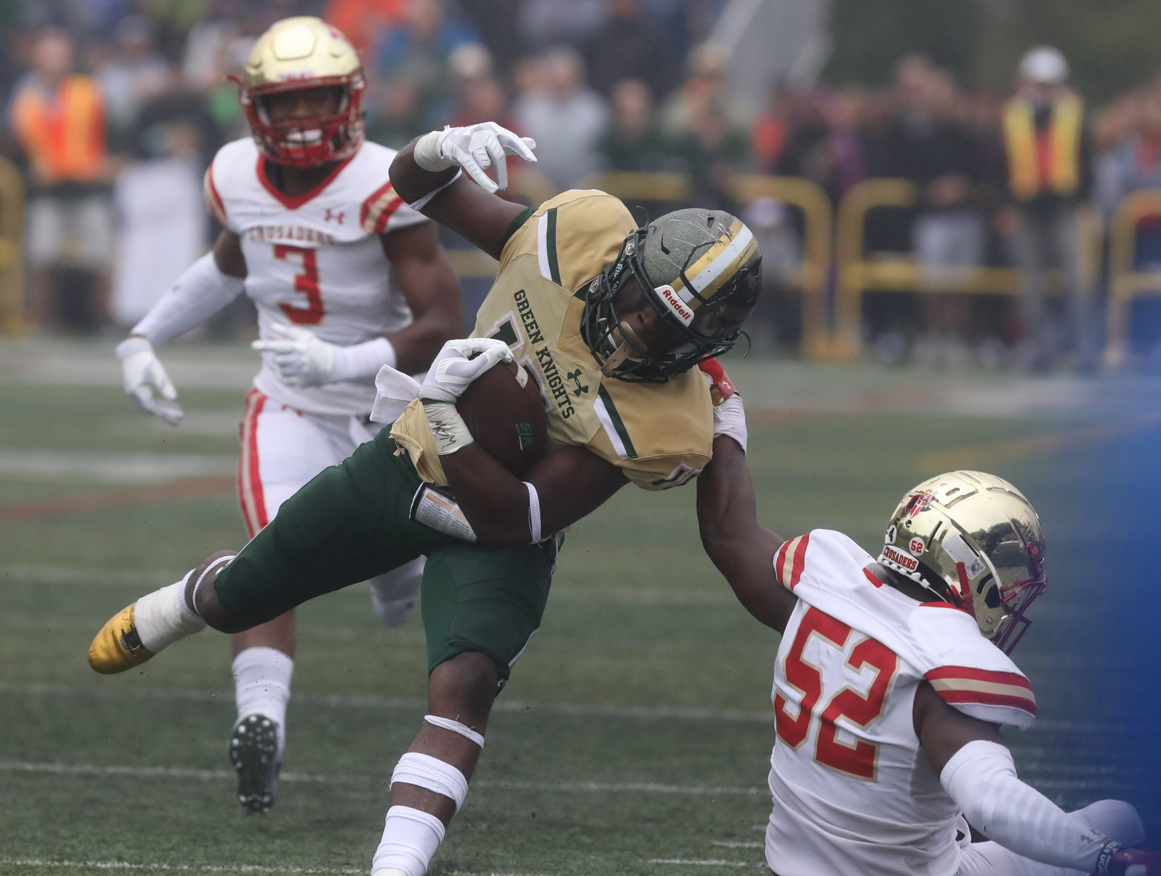 Audric Estime of St.Joseph is horse collared on this play  in the first half.