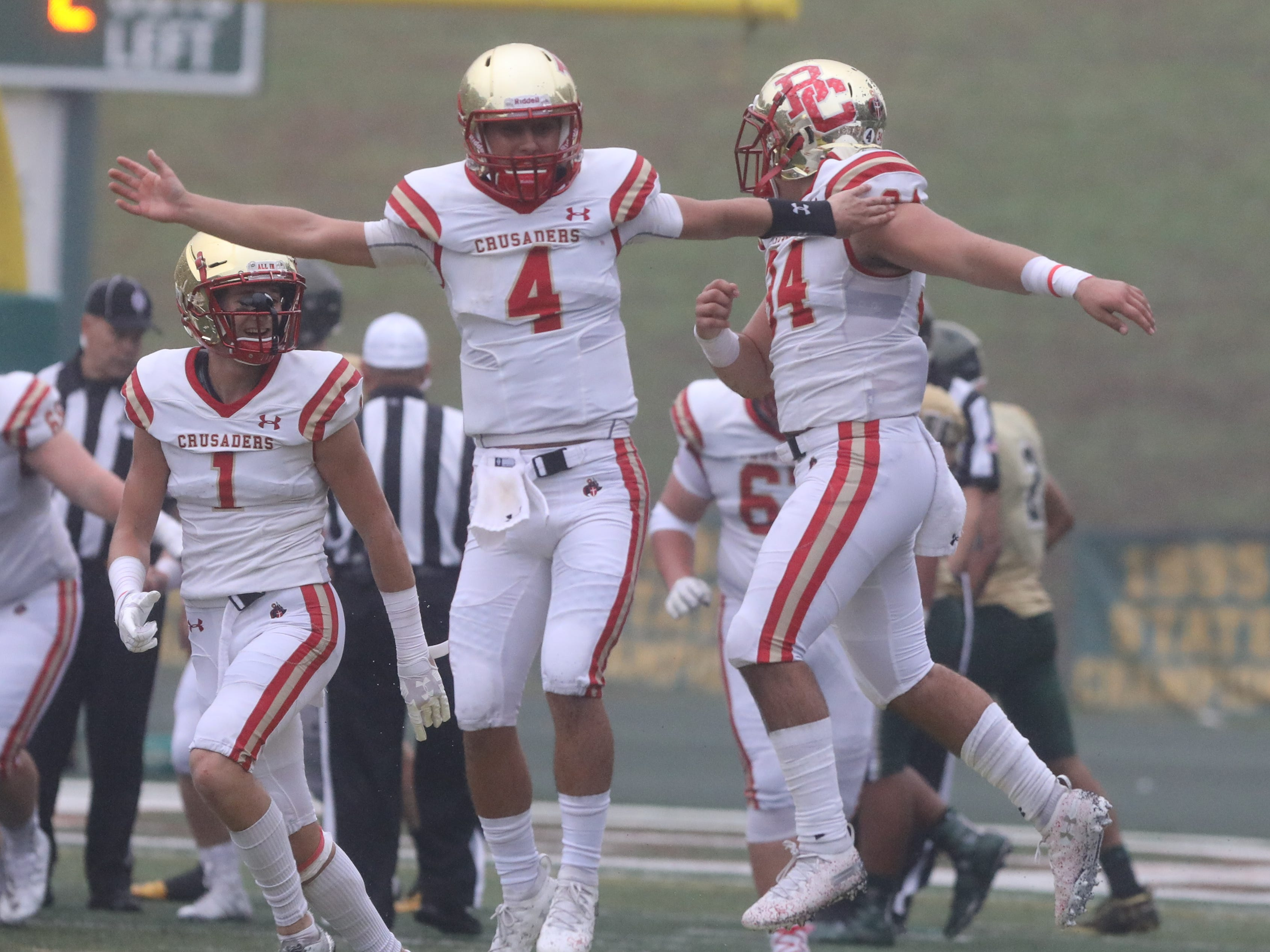 Andrew Boel of Bergen Catholic celebrates his team's win at the end of the game.
