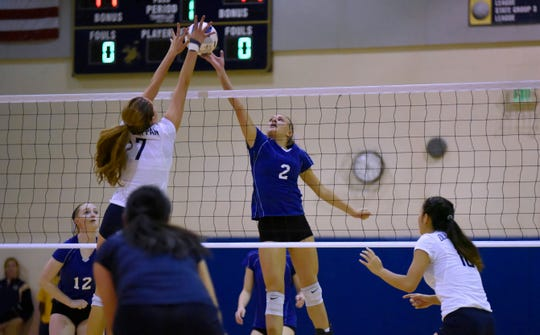 Sydney Woods (2) of NV/Demarest leaps to tip the ball over the net in a 2016 girls volleyball match against rival NV/Old Tappan.