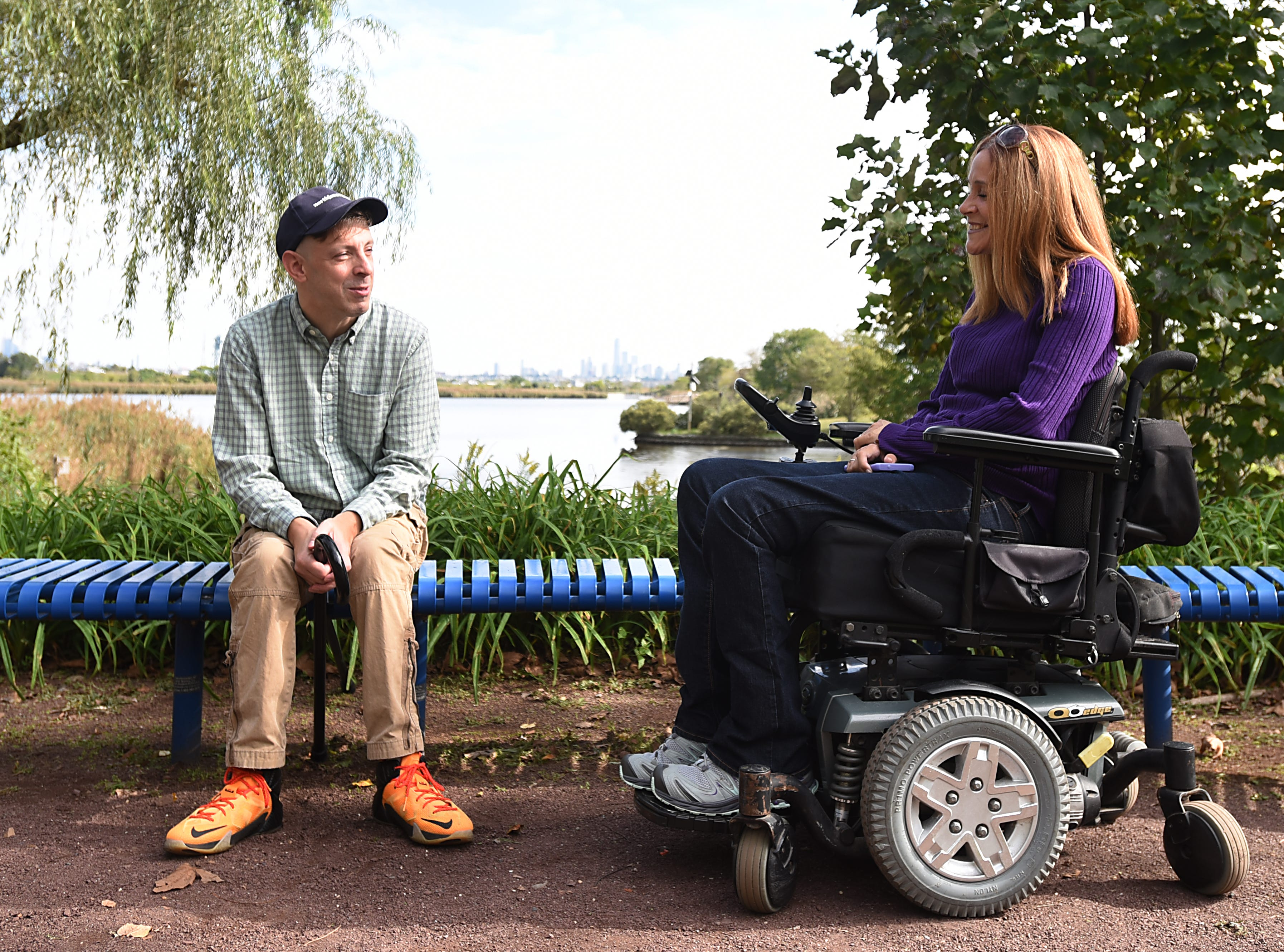 Gene Myers, reporter with NorthJersey.com and Michele Daly, Director of Disability Education at Meadowlands Environment Center and Ramapo College, pose for photos at DeKorte Park. New Jersey's hiking options for those with limited mobility, includes DeKorte Park and its accessible trails in Lyndhurst shown on Friday October 5, 2018.