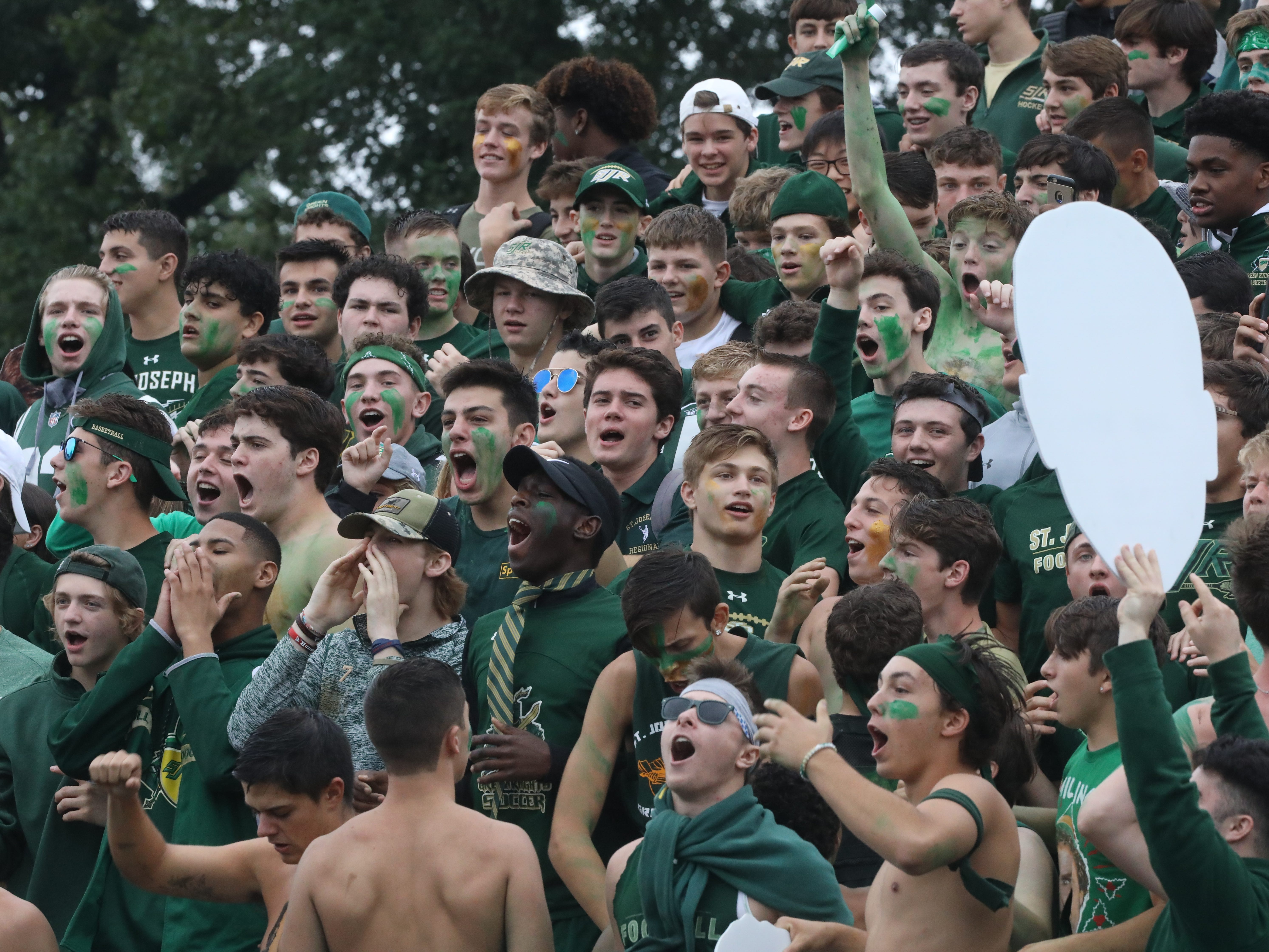 The St. Joseph sideline gets fired up before the game.