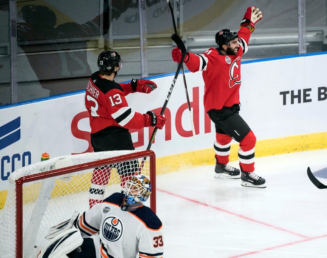 New Jersey Devils' Kyle Palmieri celebrates scoring during the season-opening NHL Global Series hockey match between Edmonton Oilers and New Jersey Devils at Scandinavium in Gothenburg, Sweden, Saturday, Oct. 6, 2018,