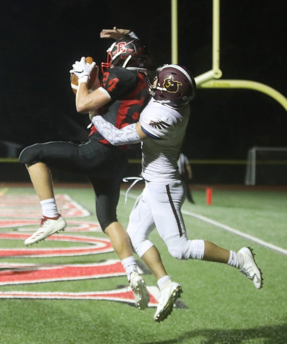 Nico Savino of Emerson catches a TD in front of Zachary Lewis of Park Ridge in the second half.