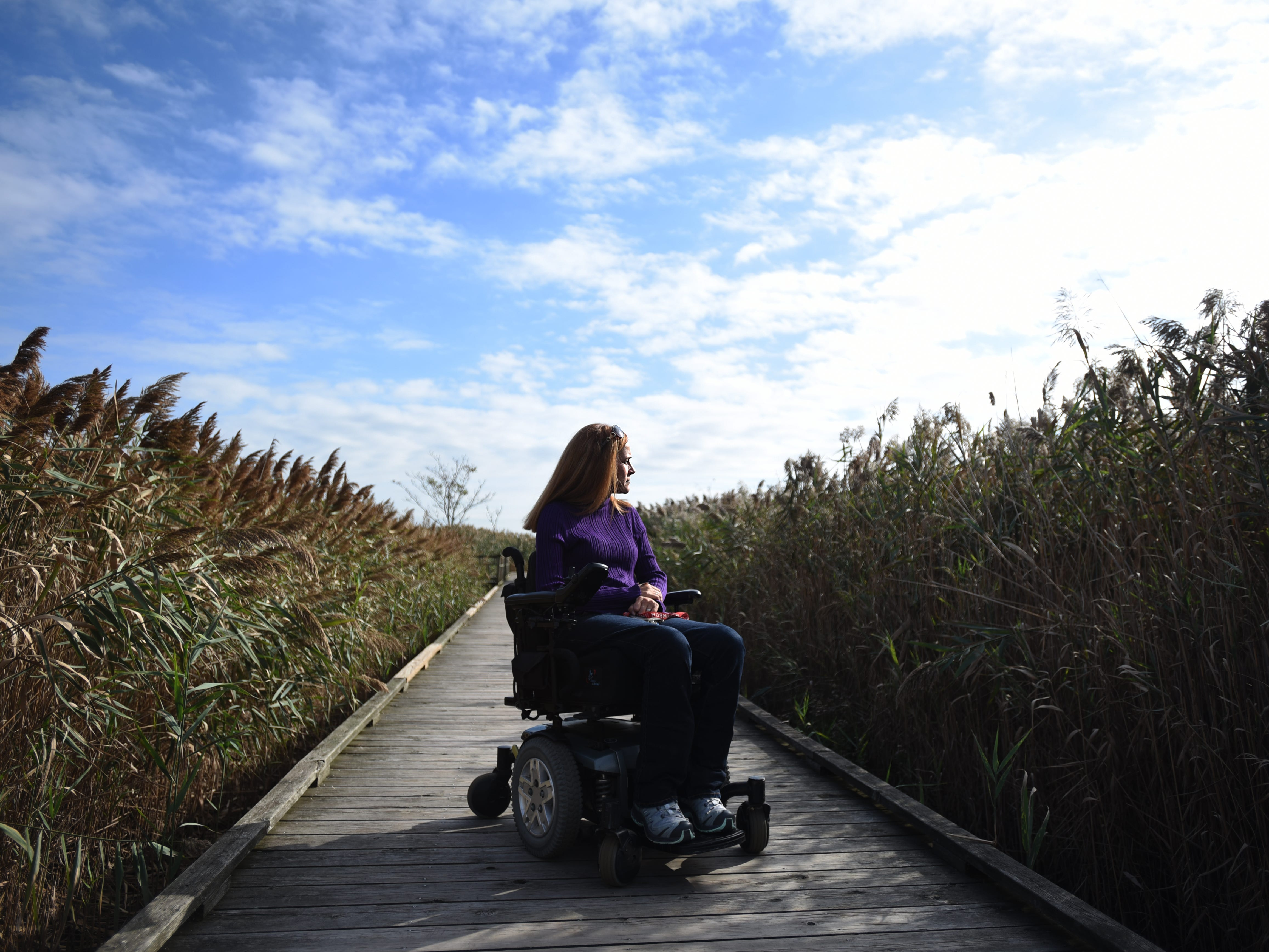Michele Daly, Director of Disability Education at Meadowlands Environment Center and Ramapo College, on one of the accessible trails at DeKorte Park. New Jersey's hiking options for those with limited mobility, includes DeKorte Park and its accessible trails in Lyndhurst shown on Friday October 5, 2018.