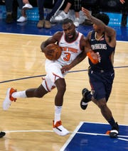 Oct 5, 2018; New York, NY, USA;  New York Knicks guard Tim Hardaway Jr. (3) drives to the basket against New Orleans Pelicans guard Elfrid Payton (4) during the second quarter at Madison Square Garden.
