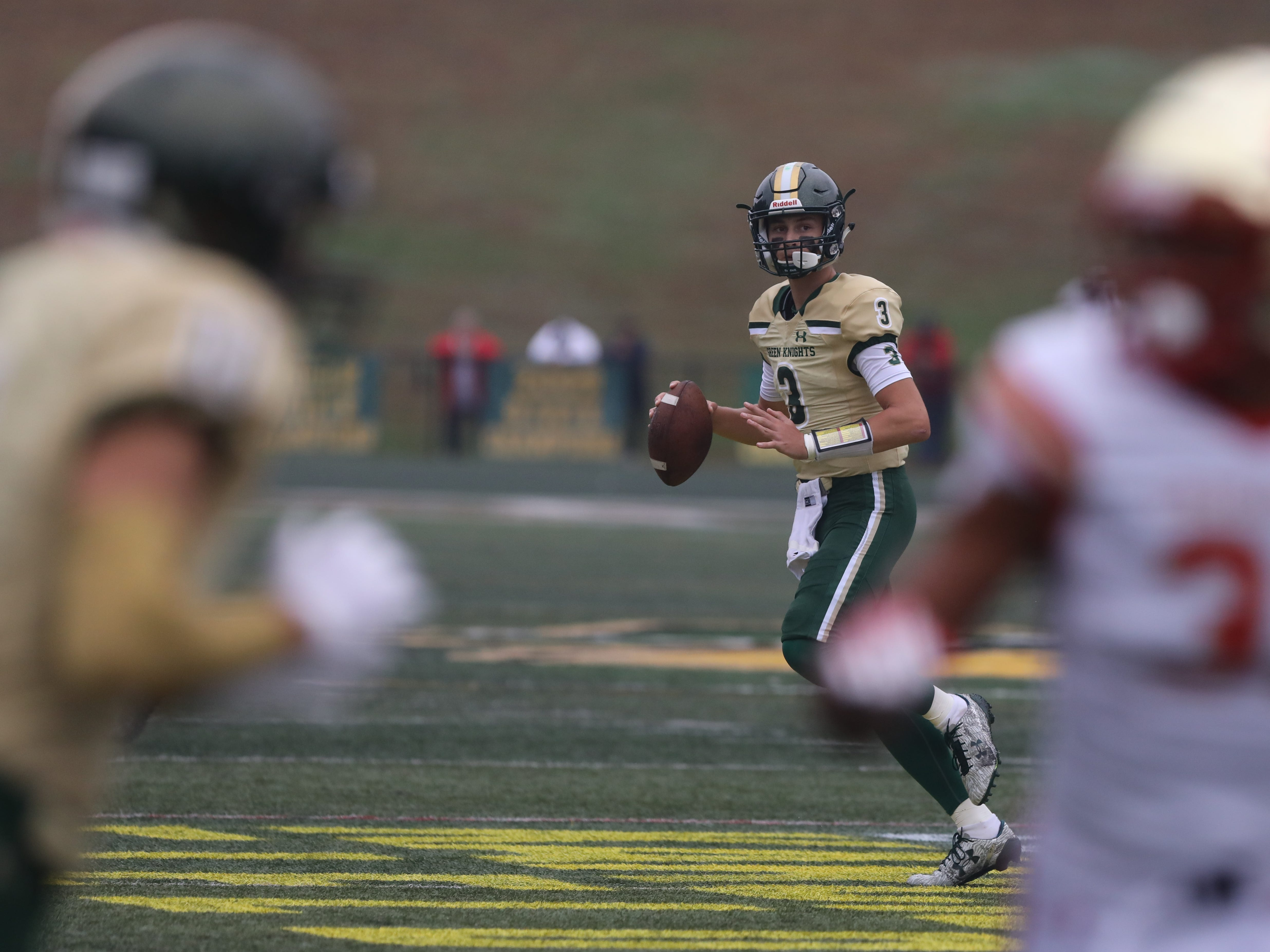 Michael Alaimo of St.Joseph looks downfield for receiver in the first half.