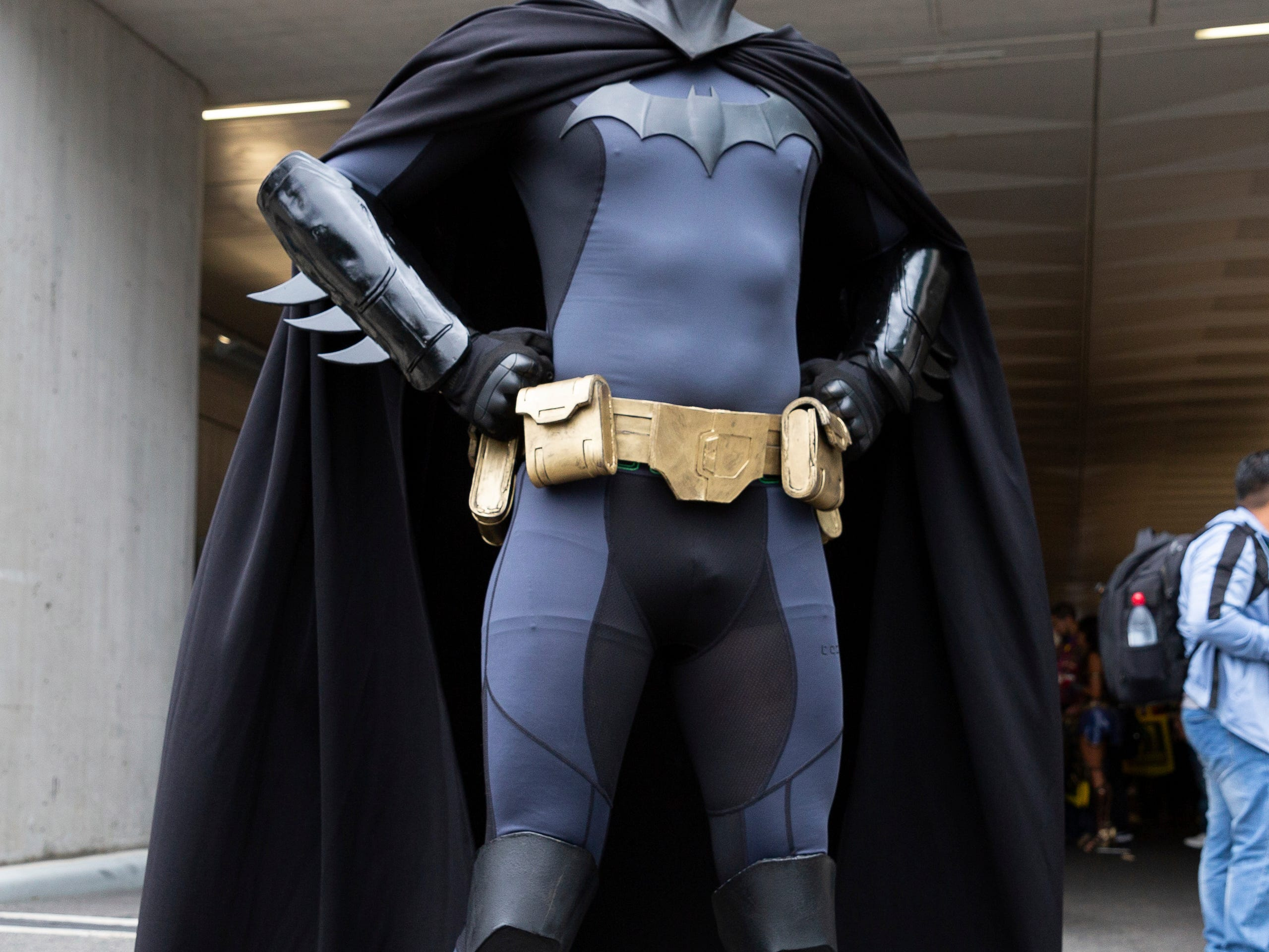An attendee dressed as Batman poses for a photo on the third day of New York Comic Con, Saturday, Oct. 6, 2018. (AP Photo/Steve Luciano)