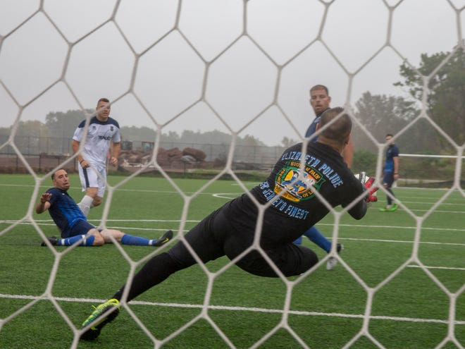 A goalie for NJ Unified blocks a shot from NJ Blue  during the Soccer Tournament to raise money for WTC victim's family on Saturday, October 6 2018 at Athenia Park. Both teams consist of police, fire and EMS workers from around the state.