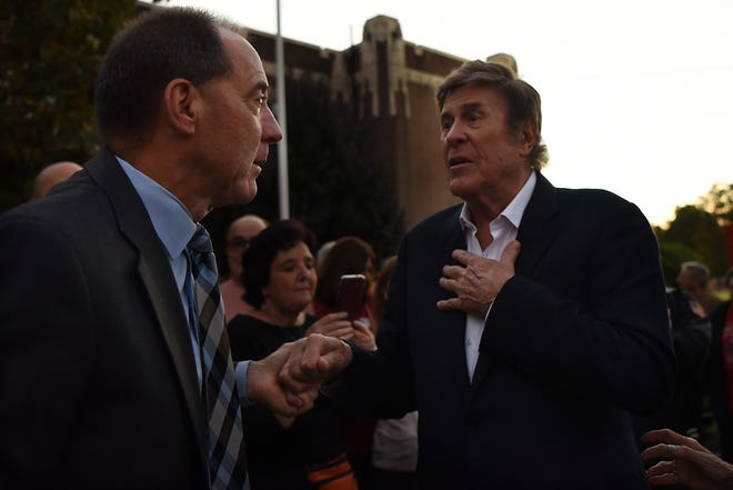 Cliffside Park Mayor Thomas Calabrese greets DJ Cousin Brucie (Bruce Morrow) during a Q&A on Cousin Brucie Day in Cliffside Park on Friday October 5, 2018.