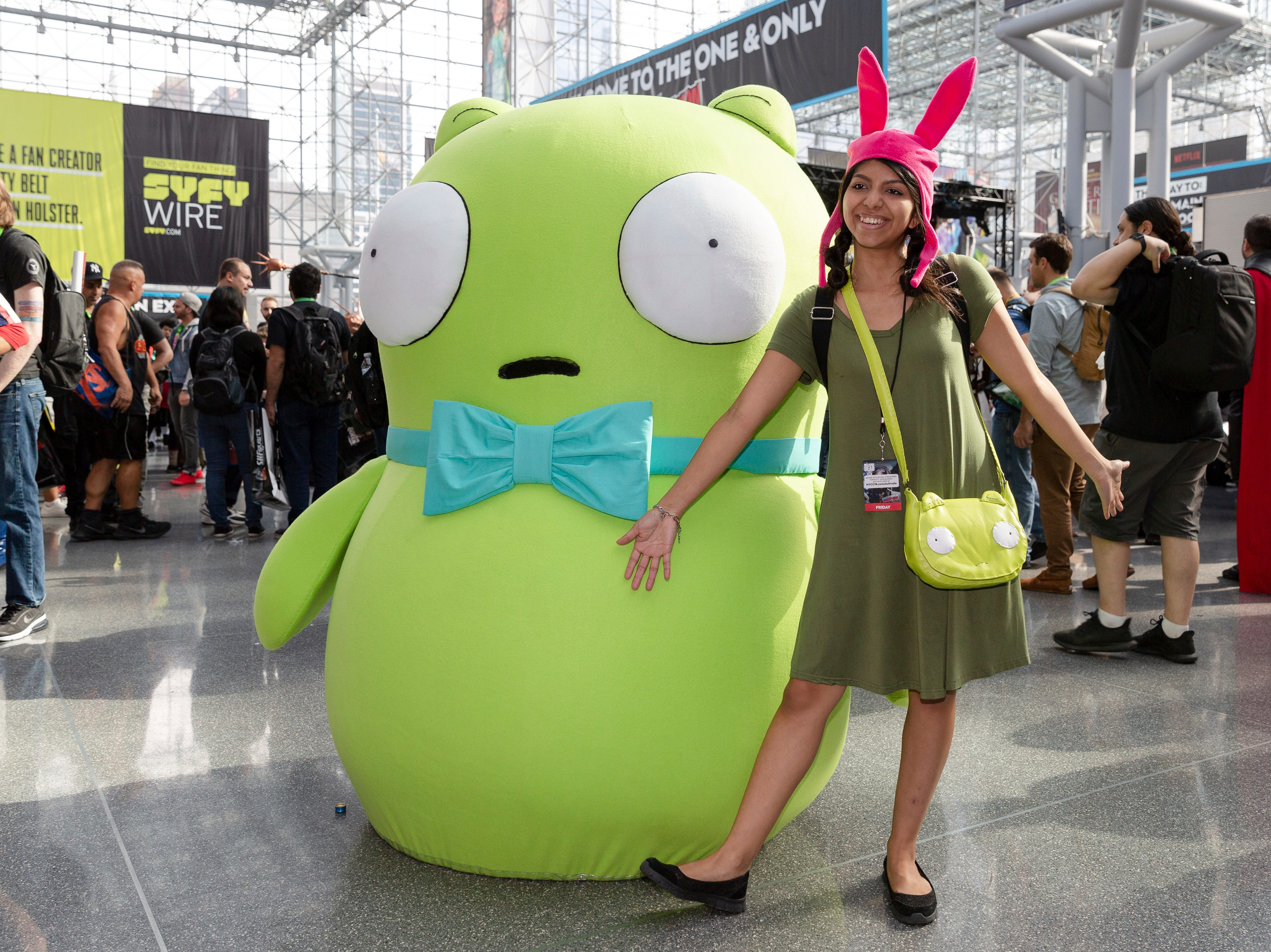 Attendees dressed in costume pose for a photo on the second day of New York Comic Con, Friday, Oct. 5, 2018. (AP Photo/Steve Luciano)