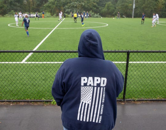 Spectator  wearing a Port Authority Police Department sweatshirt watching during the Soccer Tournament to raise money for WTC victim's family on Saturday, October 6 2018.