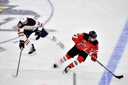 Edmonton Oilers Jujhar Khaira, left and New Jersey Devils Will Butcher vie for the puck, during the season-opening NHL Global Series hockey match between Edmonton Oilers and New Jersey Devils at Scandinavium in Gothenburg, Sweden, Saturday, Oct. 6, 2018