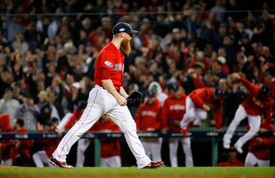 Boston Red Sox relief pitcher Craig Kimbrel celebrates after after the team's 5-4 win against the New York Yankees during Game 1 of a baseball American League Division Series on Friday, Oct. 5, 2018, in Boston.