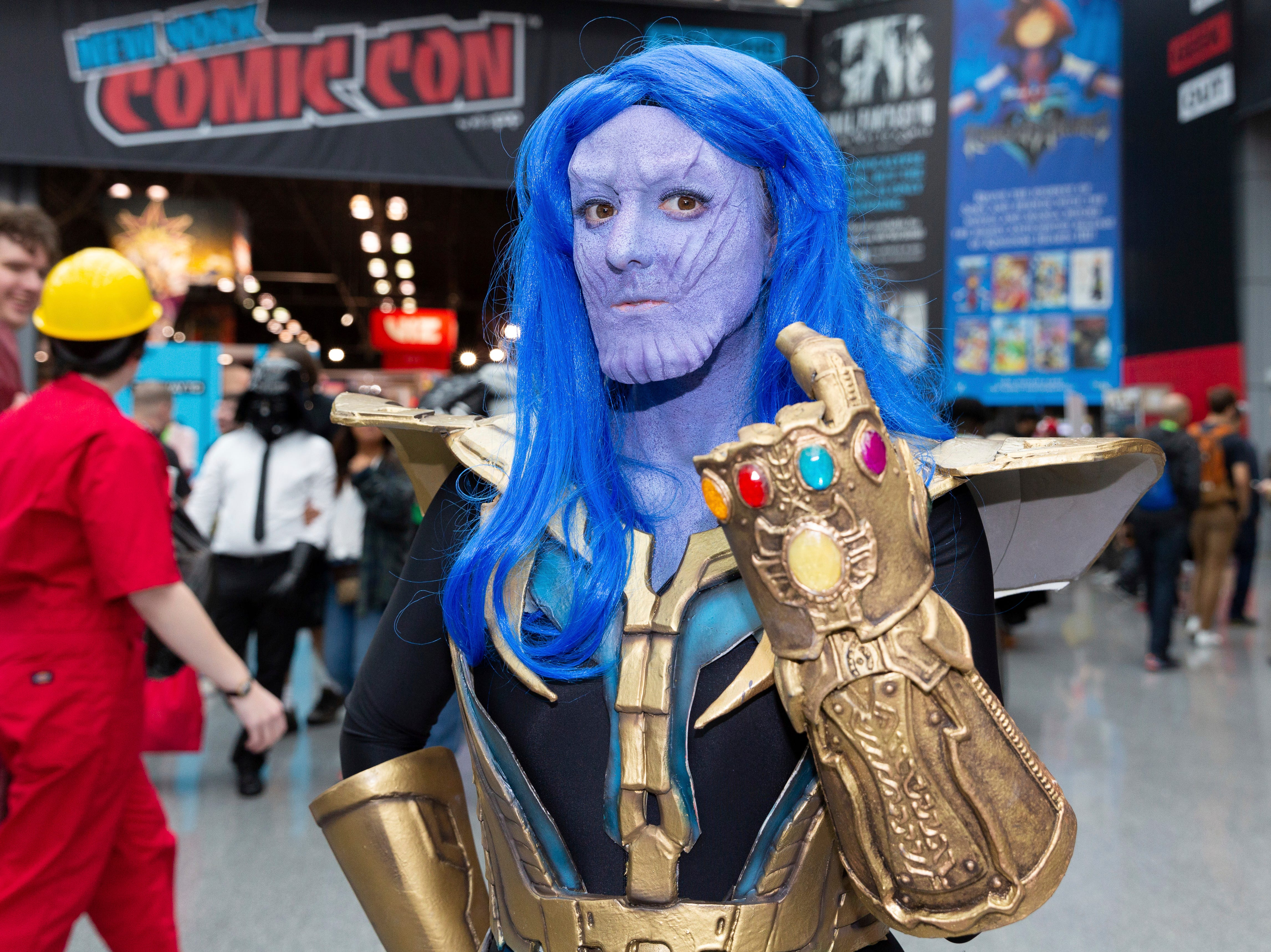 An attendee dressed in costume poses for a photo on the third day of New York Comic Con, Saturday, Oct. 6, 2018. (AP Photo/Steve Luciano)