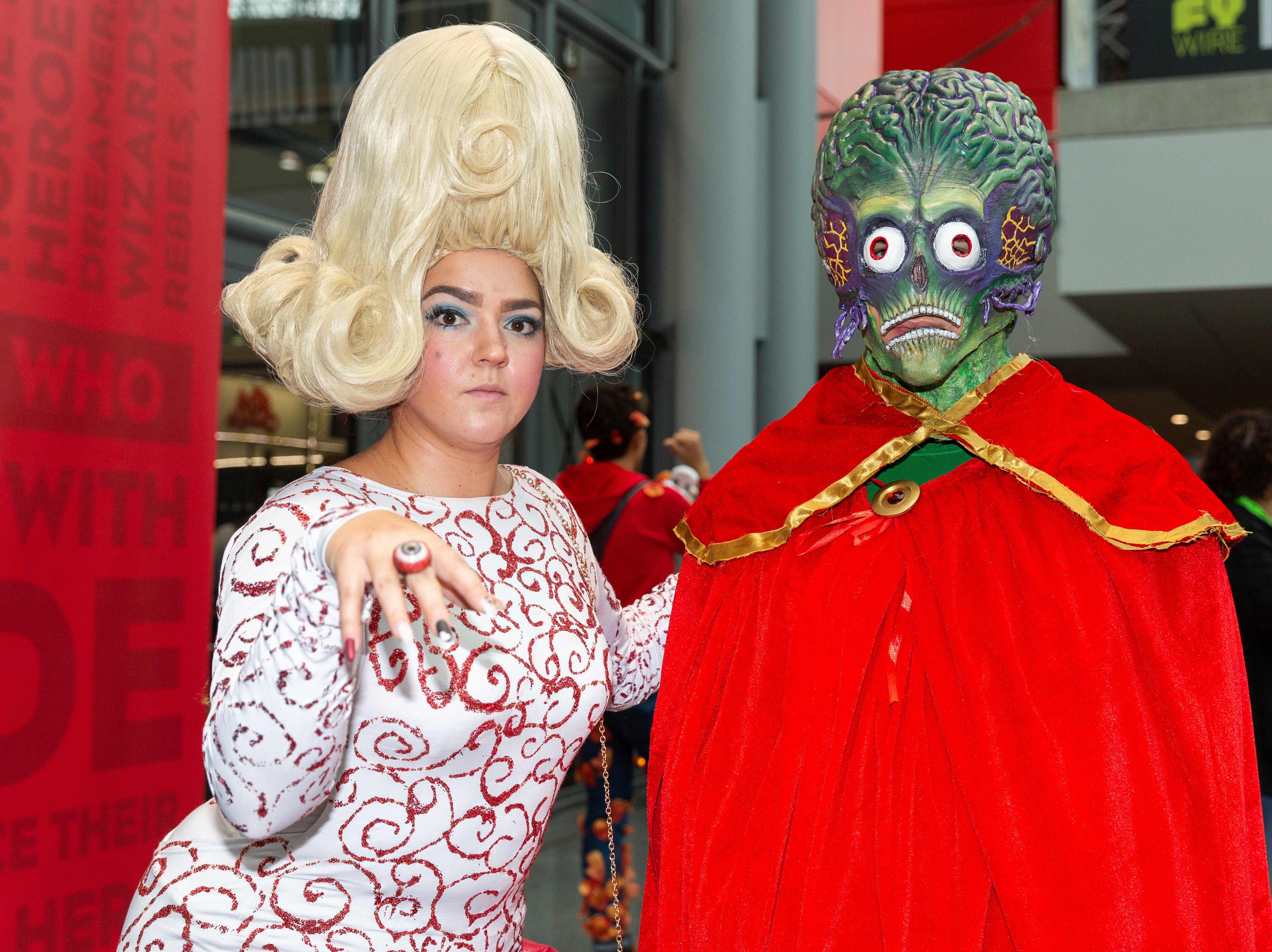 Attendees dressed in costume pose for a photo on the third day of New York Comic Con, Saturday, Oct. 6, 2018. (AP Photo/Steve Luciano)