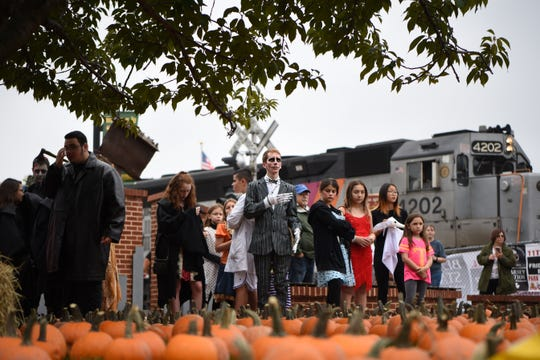 Luke Ostrow from Northvale (center) dressed as Jack Skellington from the Nightmare Before Christmas, during the Columbus Day Parade in East Rutherford on Saturday October 6, 2018.