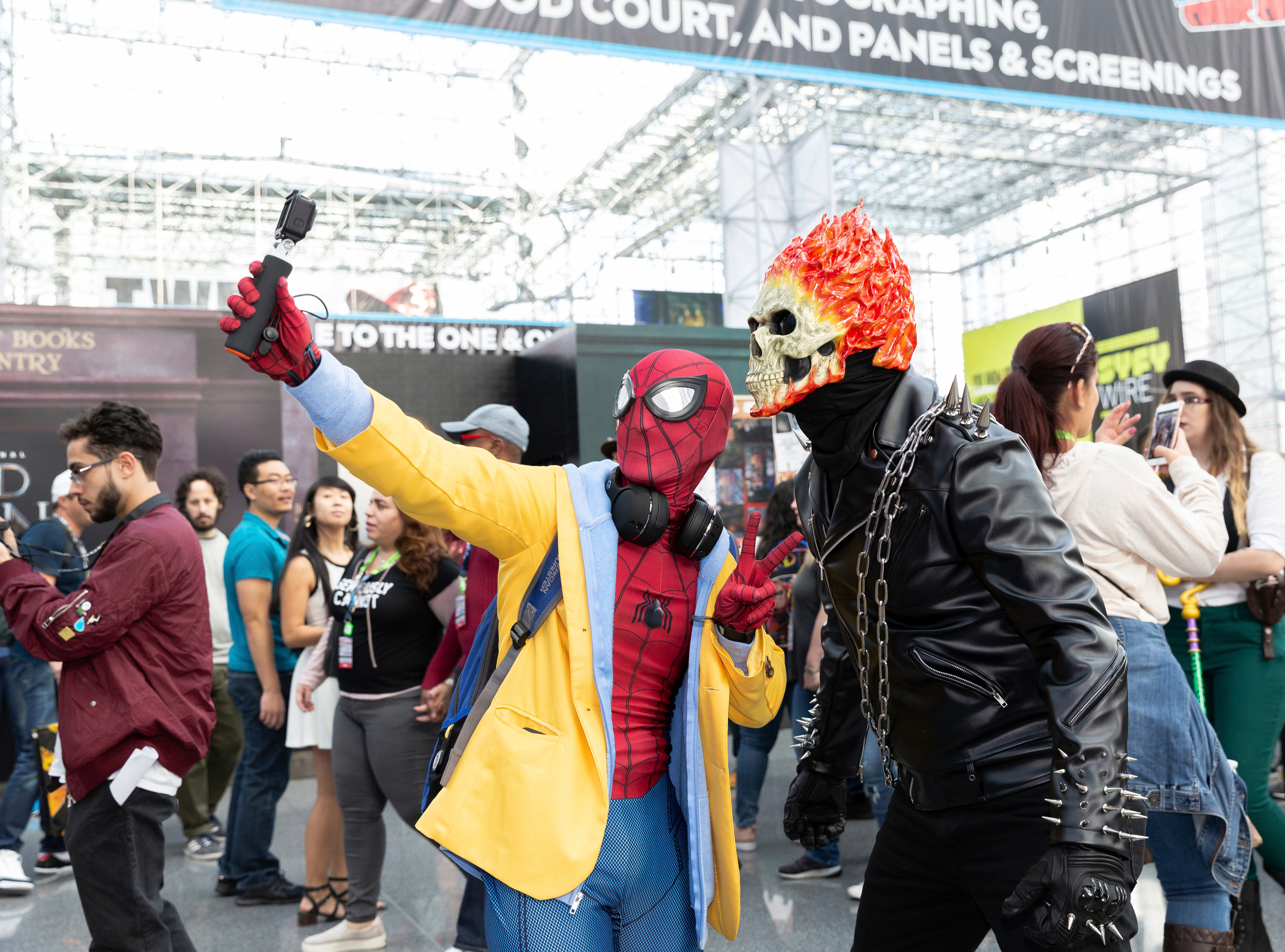 Attendees dressed in costume take a selfie on the second day of New York Comic Con, Friday, Oct. 5, 2018. (AP Photo/Steve Luciano)