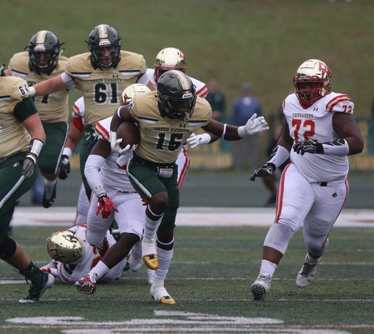 Audric Estime of St.Joseph on a 72 yard run to setup his team's field goal in the first half.