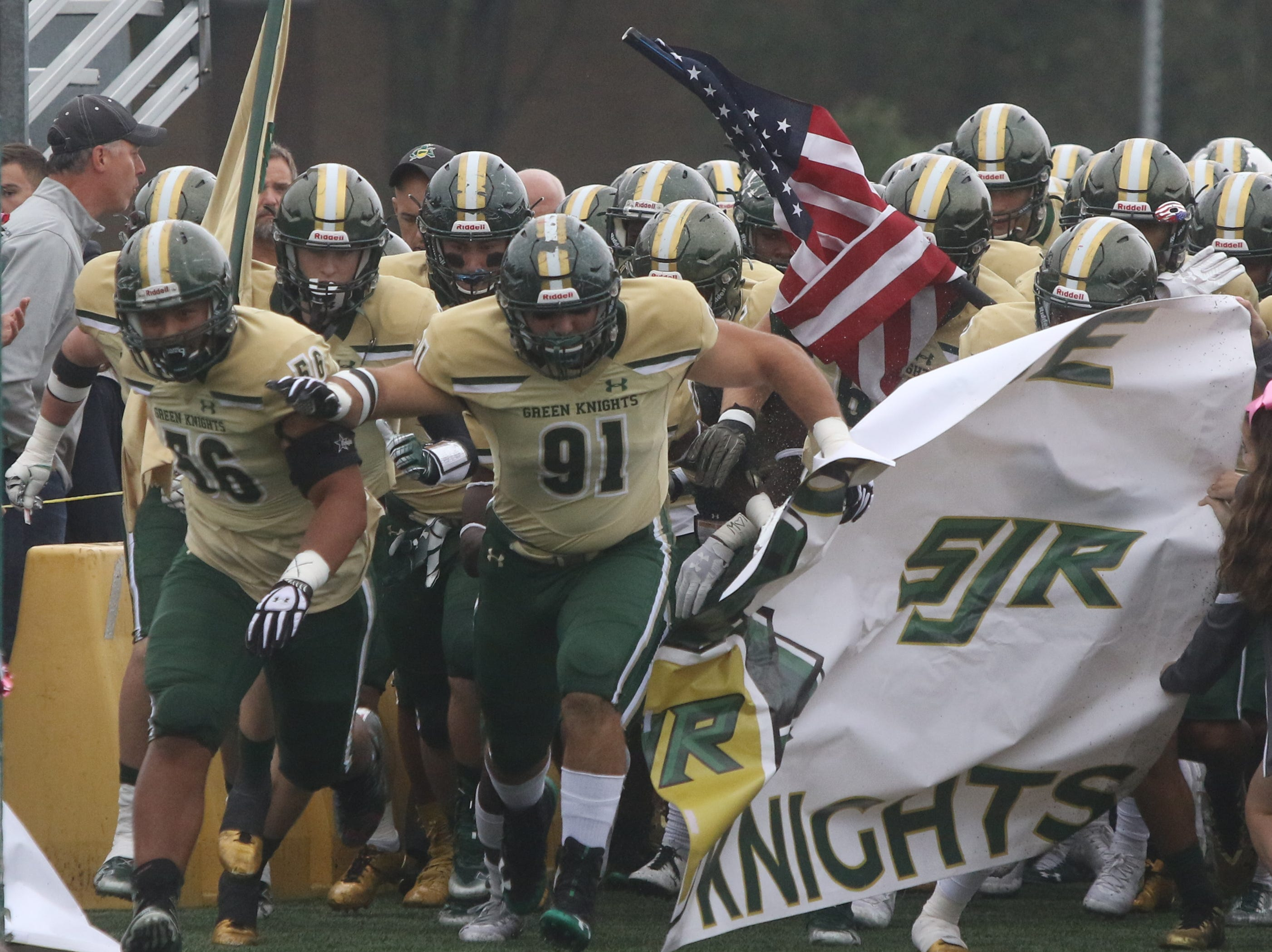 The St. Joseph Green Knights are introduced.