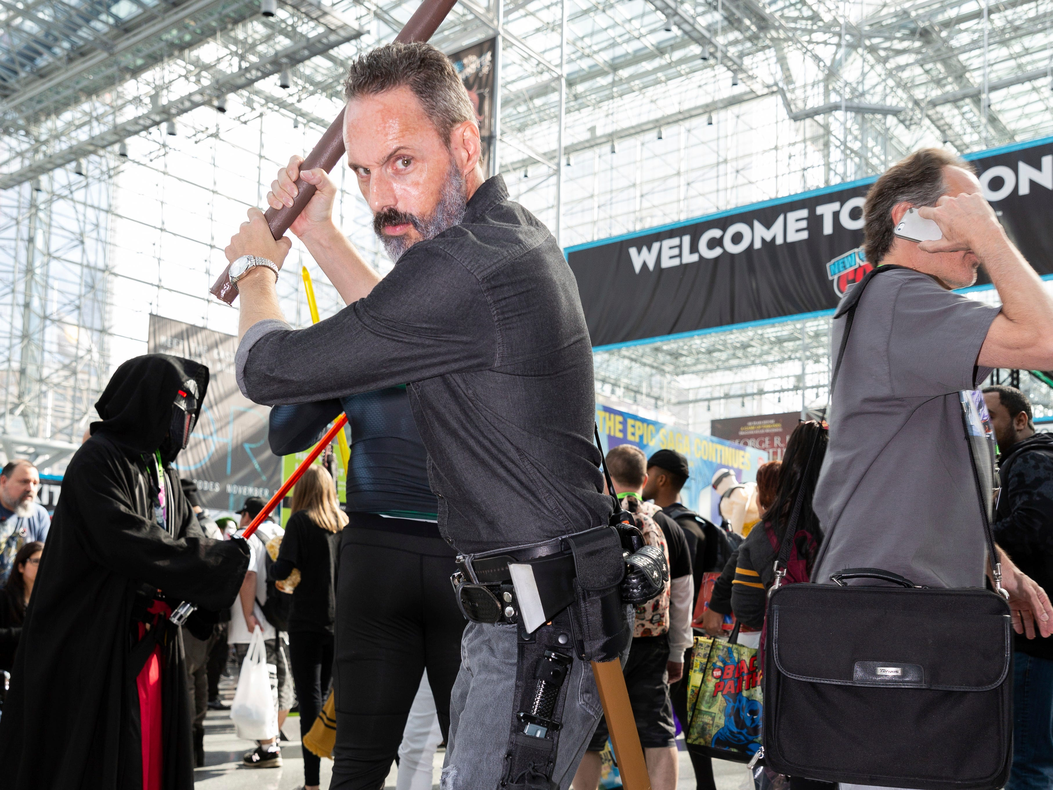 "An attendee dressed as Rick Grimes from ""The Walking Dead"" poses for a photo on the second day of New York Comic Con, Friday, Oct. 5, 2018. (AP Photo/Steve Luciano)"