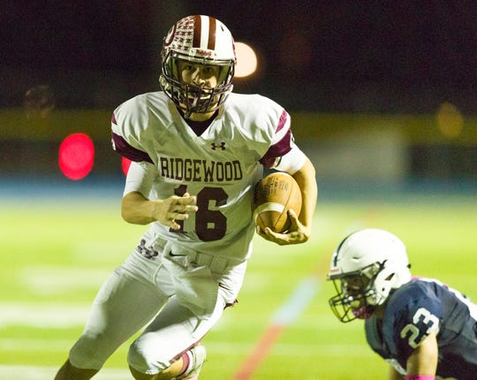 Ridgewood quarterback William Mollihan heads for the end zone in overtime against Paramus in Friday night's high school football showdown in Paramus. Paramus won the overtime thriller, 35-34, on Oct. 5, 2018
