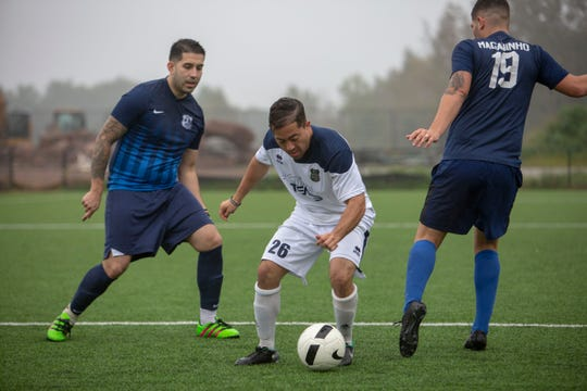 In white, a member of the NJ Blue team and in Blue/Black members of the NJ Unified team play during the Soccer Tournament to raise money for WTC victim's family on Saturday, October 6 2018 at Athenia Park. Both teams consist of police, fire and EMS workers from around the state.