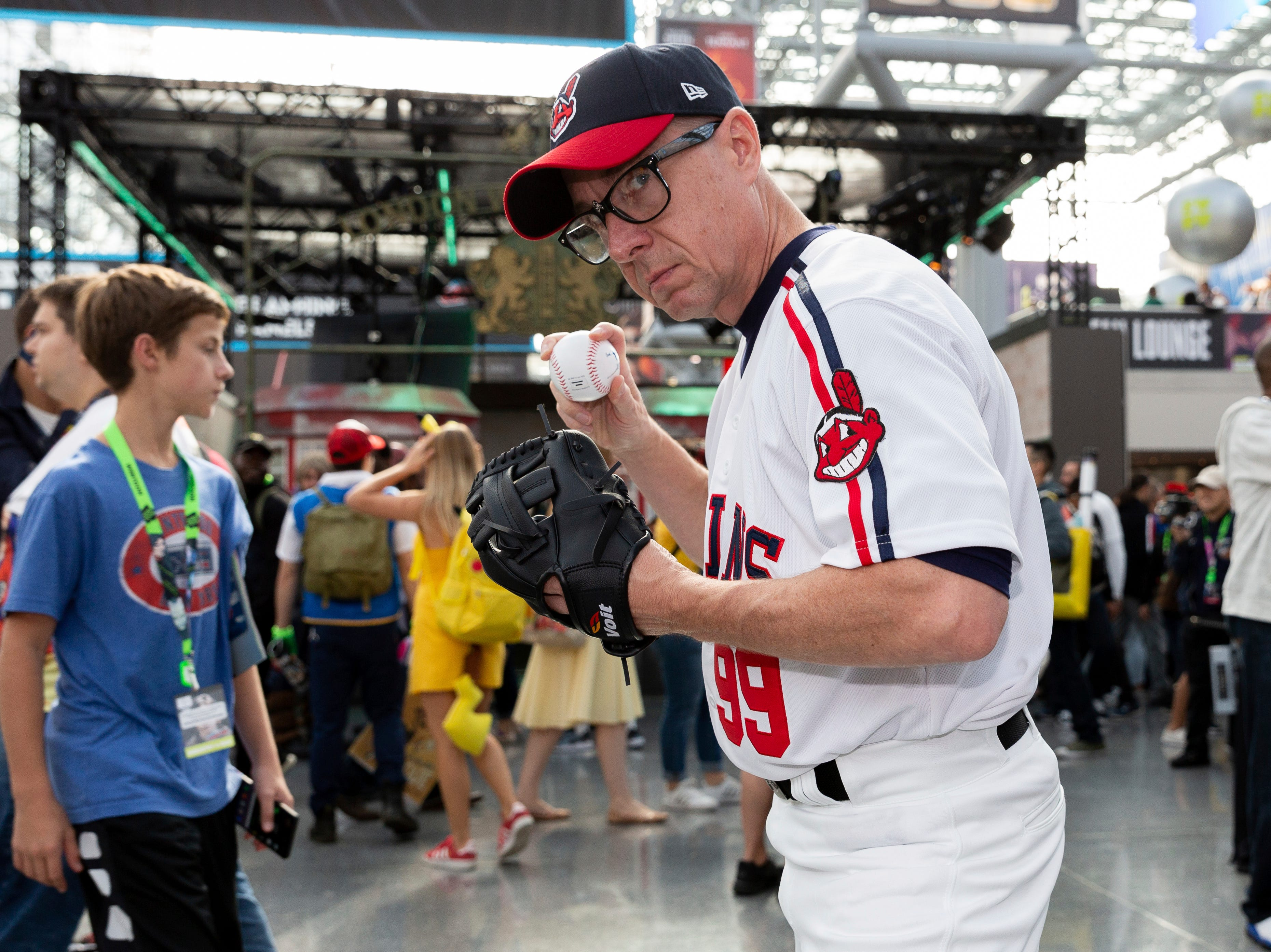 "An attendee dressed as Ricky Vaughn from the movie ""Major League"" poses for a photo on the second day of New York Comic Con, Friday, Oct. 5, 2018. (AP Photo/Steve Luciano)"