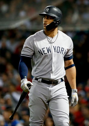 New York Yankees' Giancarlo Stanton walks away after striking out during the seventh inning against the Boston Red Sox in Game 1 of a baseball American League Division Series on Friday, Oct. 5, 2018, in Boston.