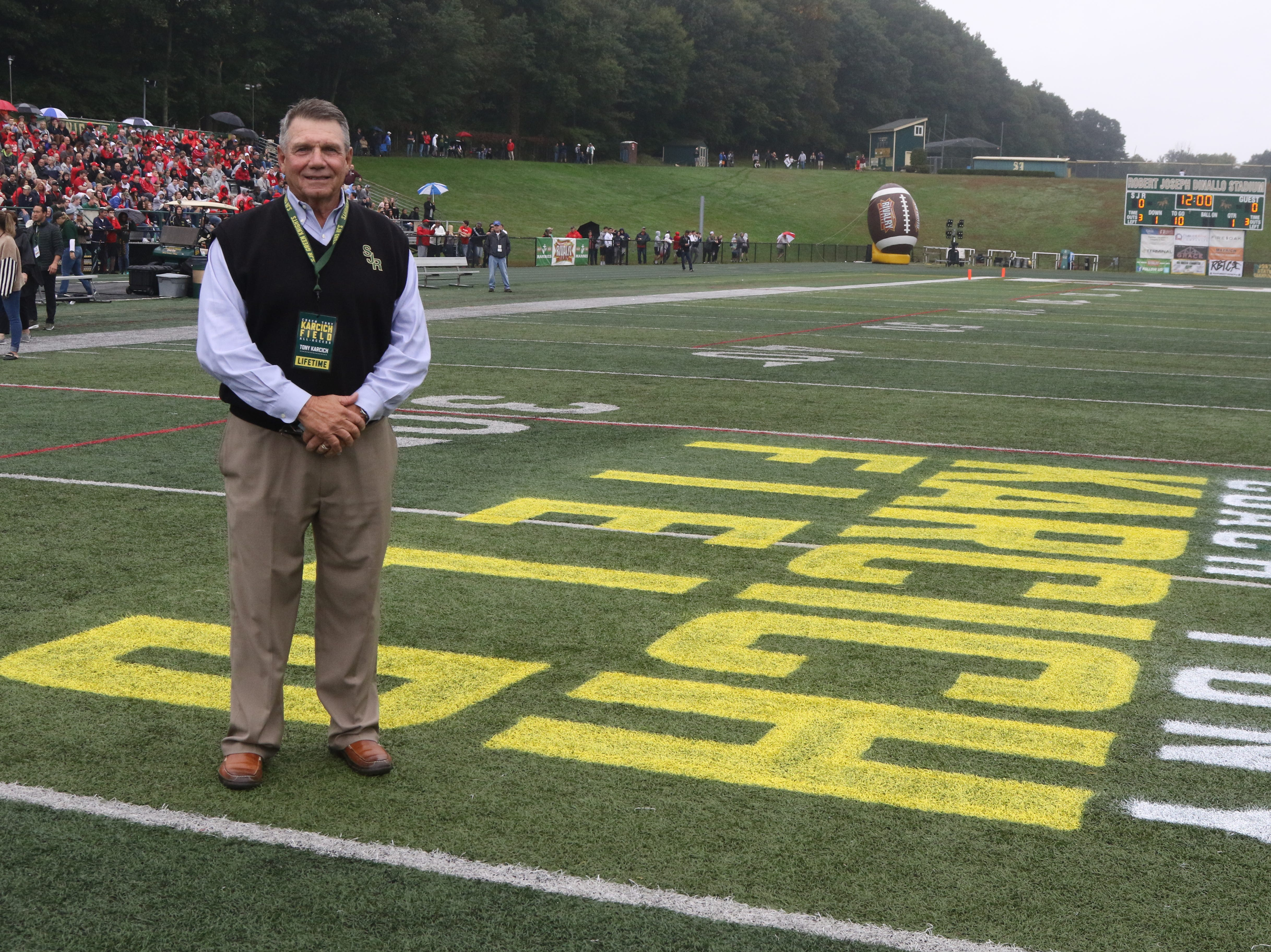 Former St. Joseph Coach, Tony Karcich during a ceremony honoring Karcich and naming the St. Joseph field after him.