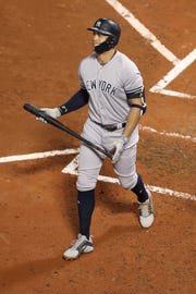 Oct 5, 2018; Boston, MA, USA; New York Yankees designated hitter Giancarlo Stanton (27) walks to dugout after striking out during the fourth inning against the Boston Red Sox in game one of the 2018 NLDS playoff baseball series at Fenway Park.