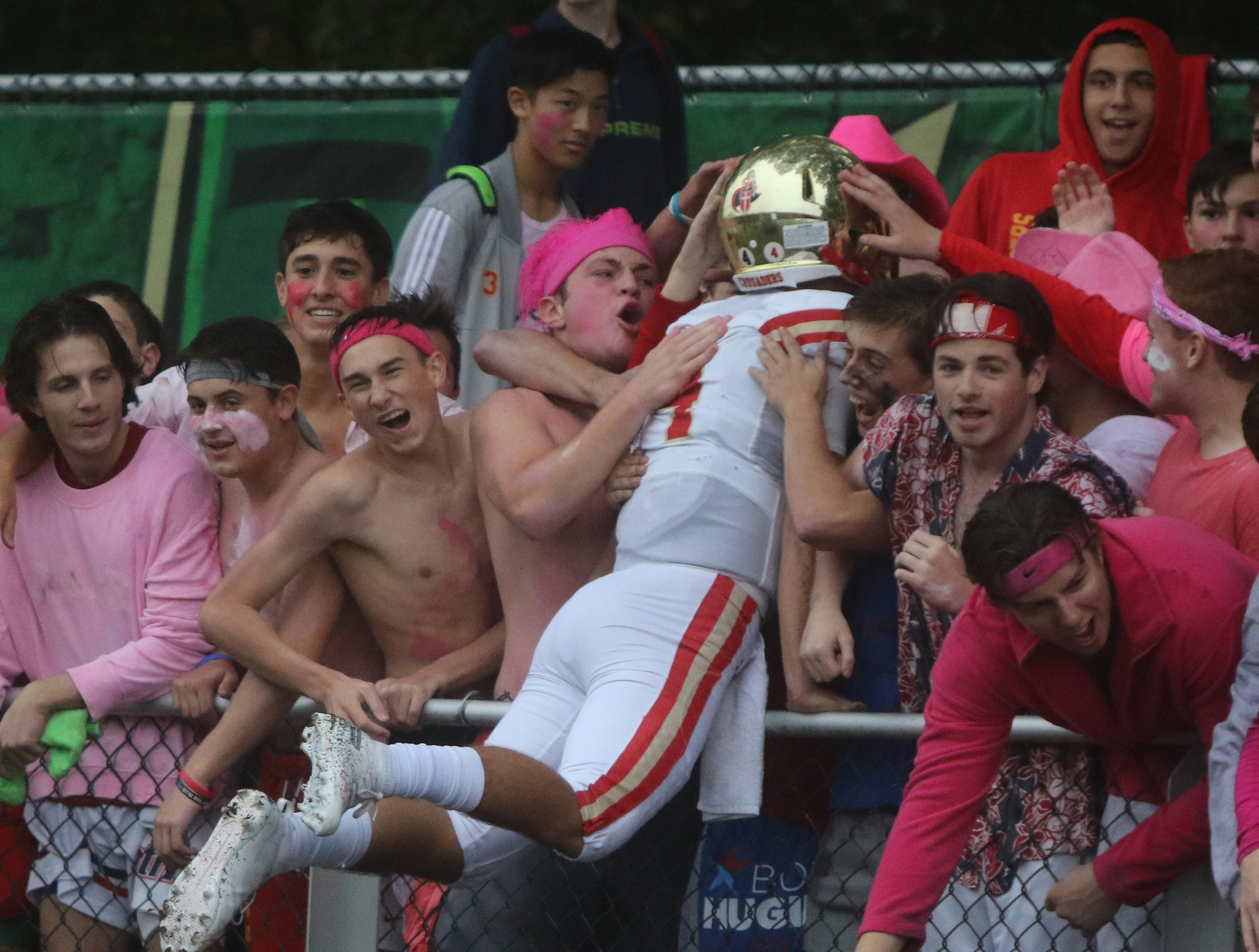 Andrew Boel of Bergen Catholic jumps into the crowd after defeating St. Joseph.