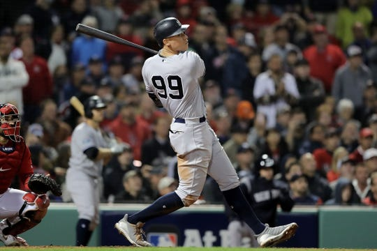 BOSTON, MA - OCTOBER 05:  Aaron Judge #99 of the New York Yankees hits a solo home run in the ninth inning against the Boston Red Sox in Game One of the American League Division Series at Fenway Park on October 5, 2018 in Boston, Massachusetts.