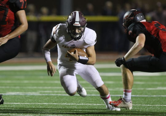 Quarterback, Vincent Pinto of Park Ridge runs the ball in the first half.