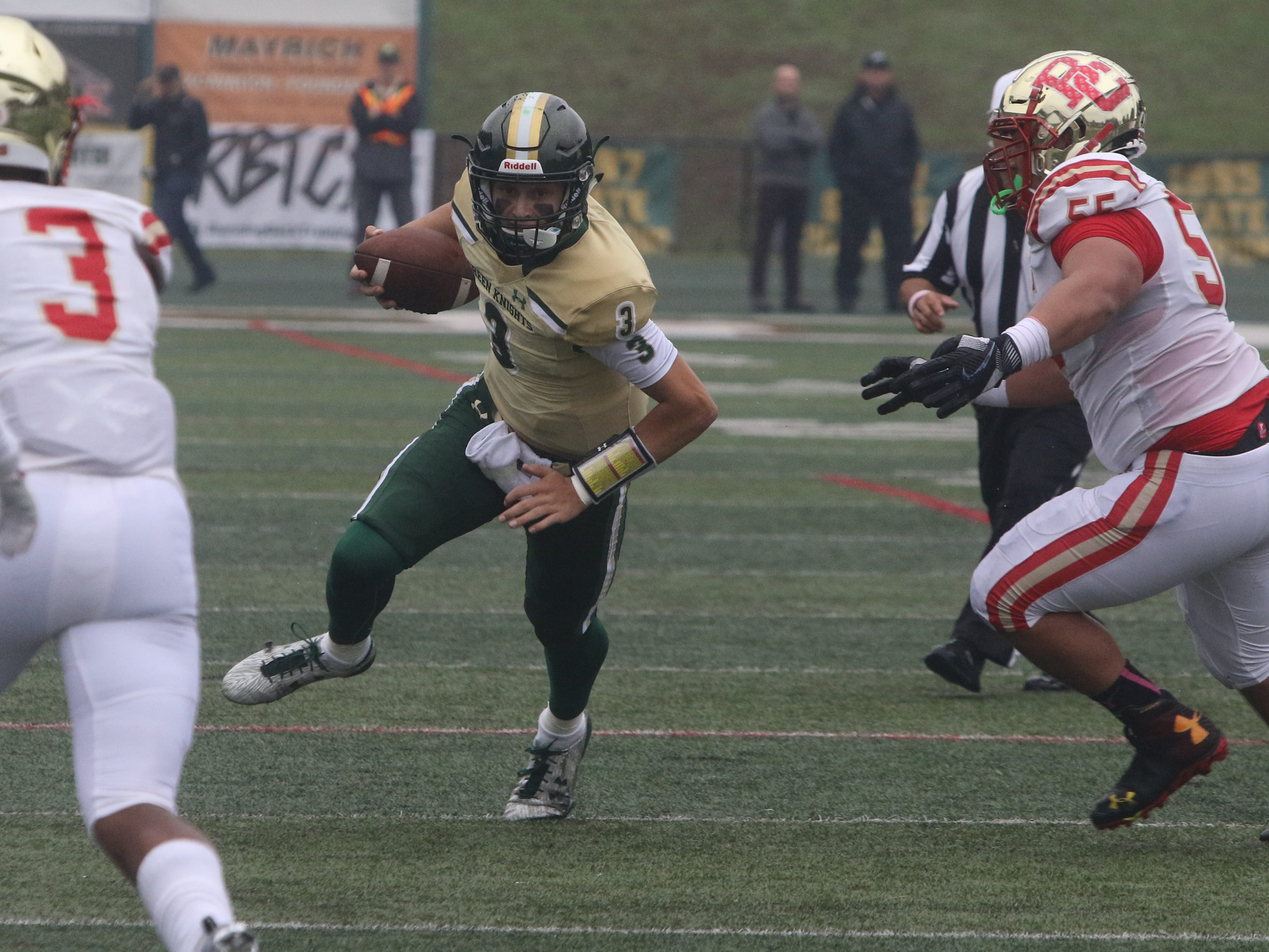 Quarterback Michael Alaimo of St.Joseph carries the ball in the first half.