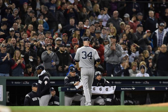 Oct 5, 2018; Boston, MA, USA; New York Yankees starting pitcher J.A. Happ (34) walks to the dugout after leaving the game in the third inning against the Boston Red Sox of game one of the 2018 NLDS playoff baseball series at Fenway Park.