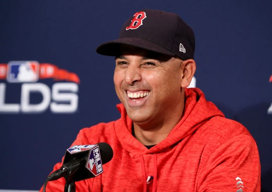 Boston Red Sox manager Alex Cora talks during a news conference before Game 1 of a baseball American League Division Series against the New York Yankees on Friday, Oct. 5, 2018, in Boston.