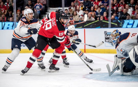 New Jersey Devils' Travis Zajac scores during the season-opening NHL Global Series hockey match between Edmonton Oilers and New Jersey Devils at Scandinavium in Gothenburg, Sweden, Saturday, Oct. 6, 2018,
