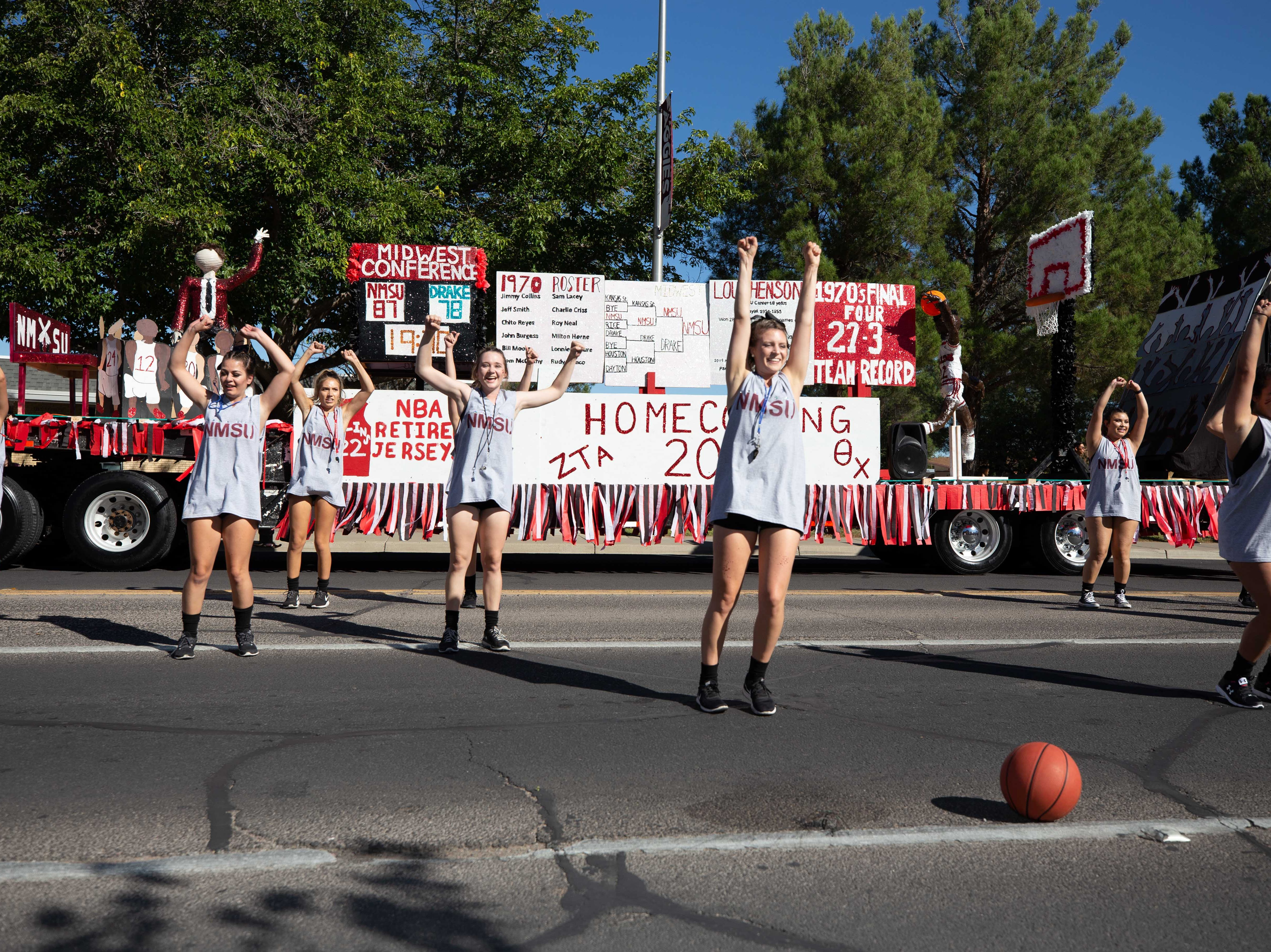 Zeta Tau Alpha and Theta Chi members at the NMSU Homecoming Parade on October 6, 2018.
