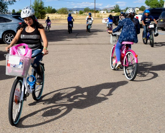 Participant of the Meadow Lake Kids Club test out their new bicycles with a ride around the parking lot. The youth received the bicycles after performing a variety of acts of kindness.