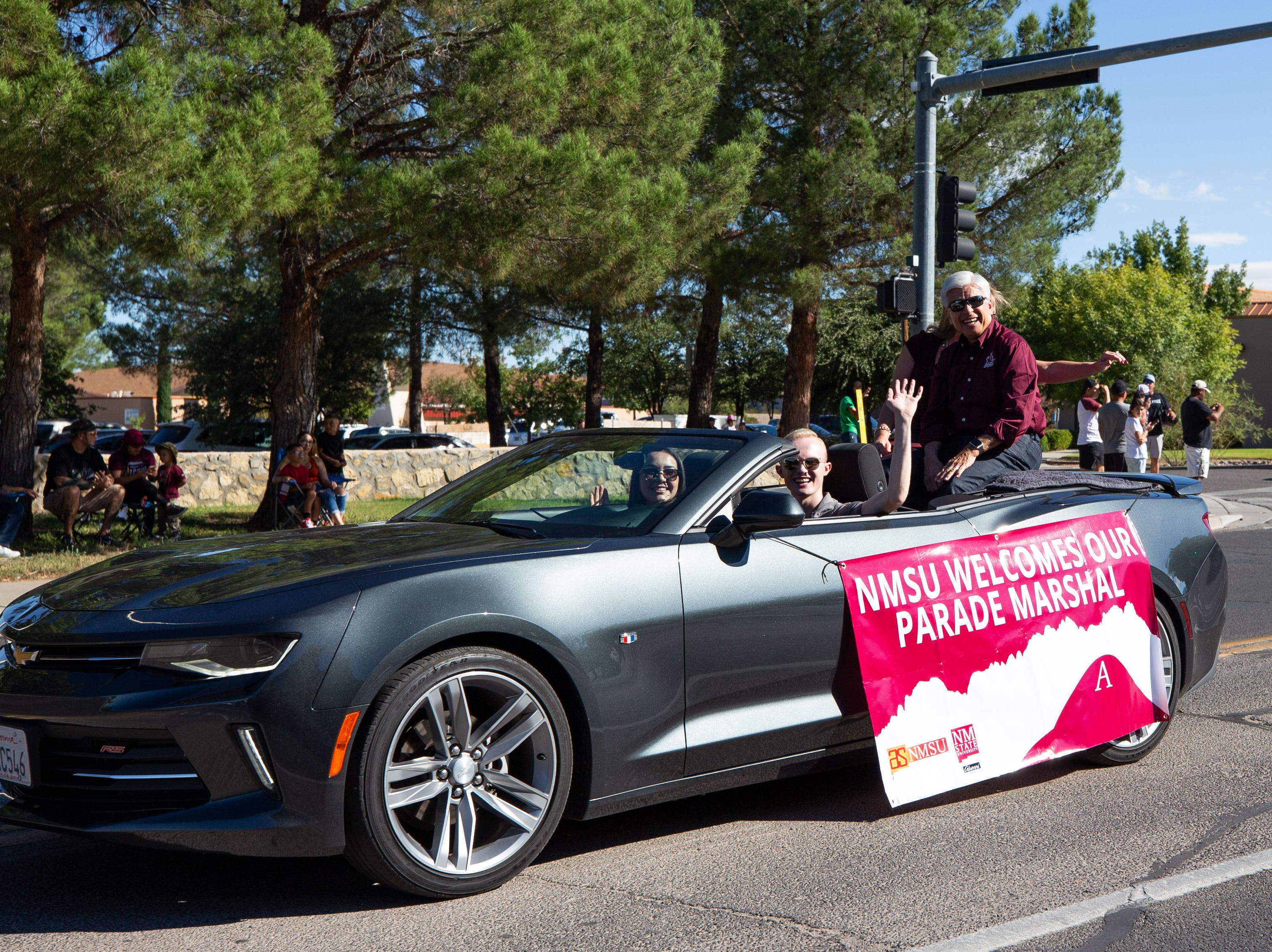 Parade Marshal, NMSU Chancellor Arvizu. Driving the car is ASNMSU President Emerson Morrow and ASNMSU Vice President, Linda Cisneros at the NMSU Homecoming Parade on October 6, 2018.