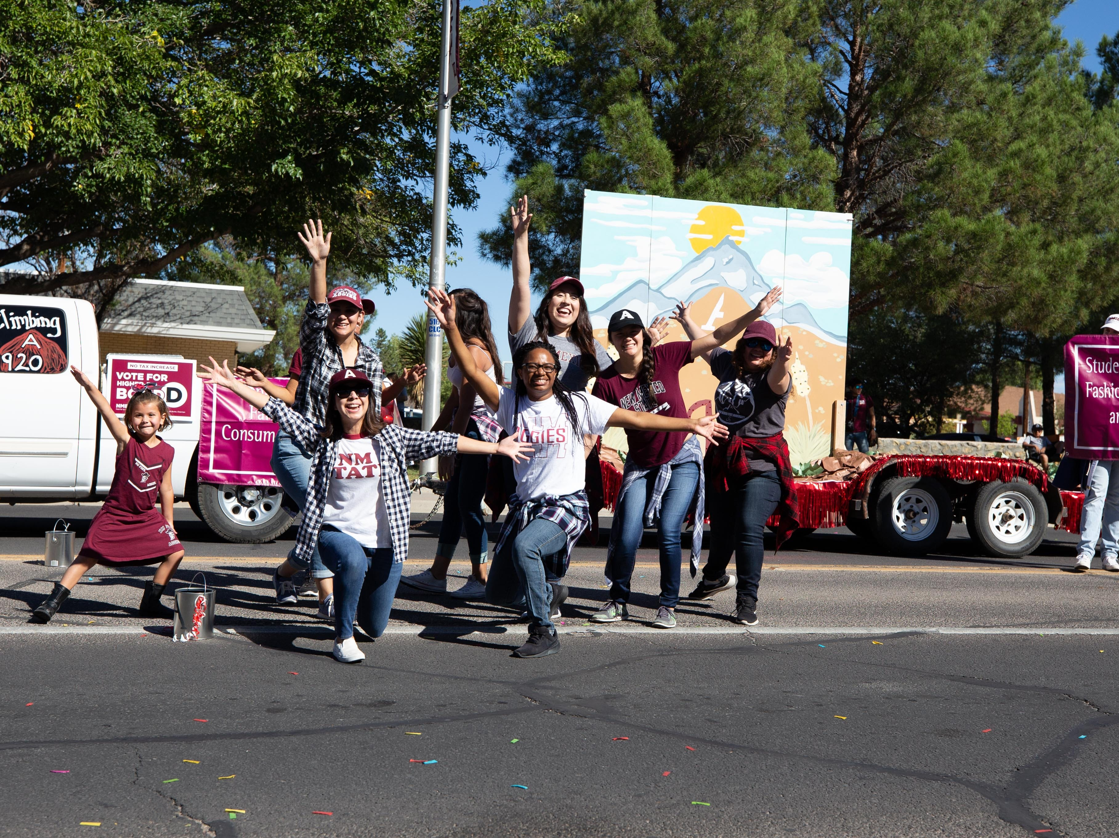 Student Association of Fashion Merchandising and Marketing float and participants at the NMSU Homecoming Parade on October 6, 2018.