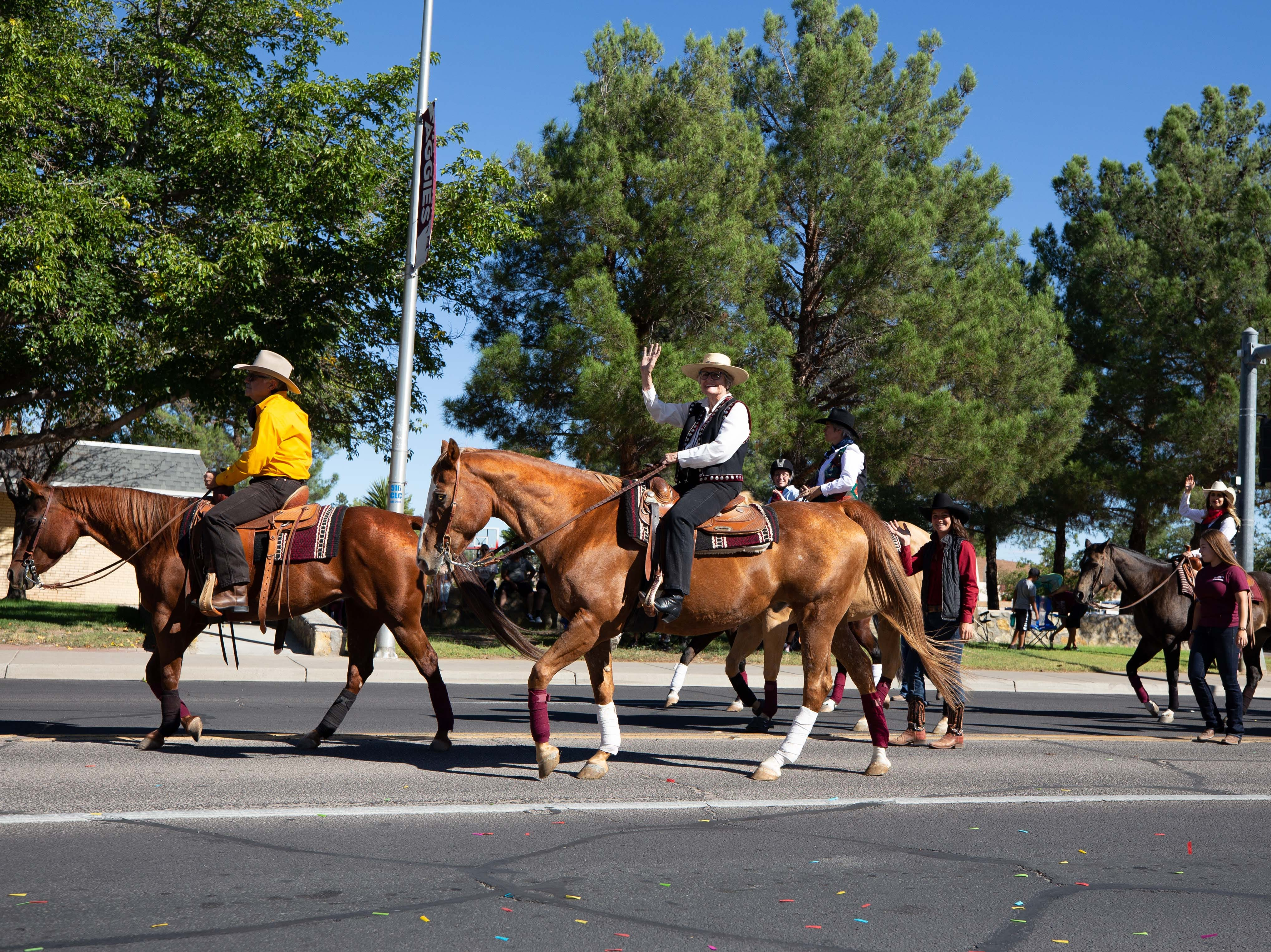 Dean Rolando Flores, Senator Mary Kay Papen and Allison Smith on horses at the NMSU Homecoming Parade on October 6, 2018.