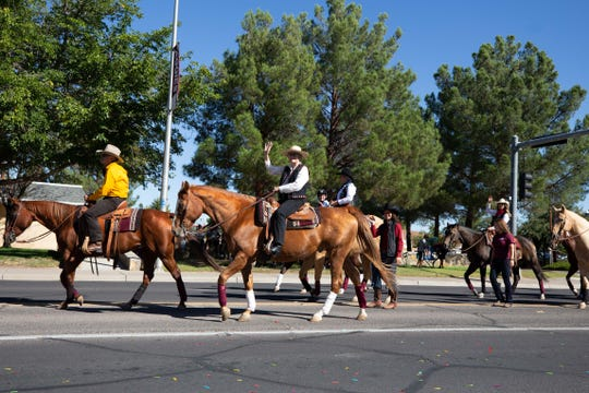 Dean Rolando Flores, state Senator Mary Kay Papen and Allison Smith on horses at the NMSU Homecoming Parade on October 6, 2018.