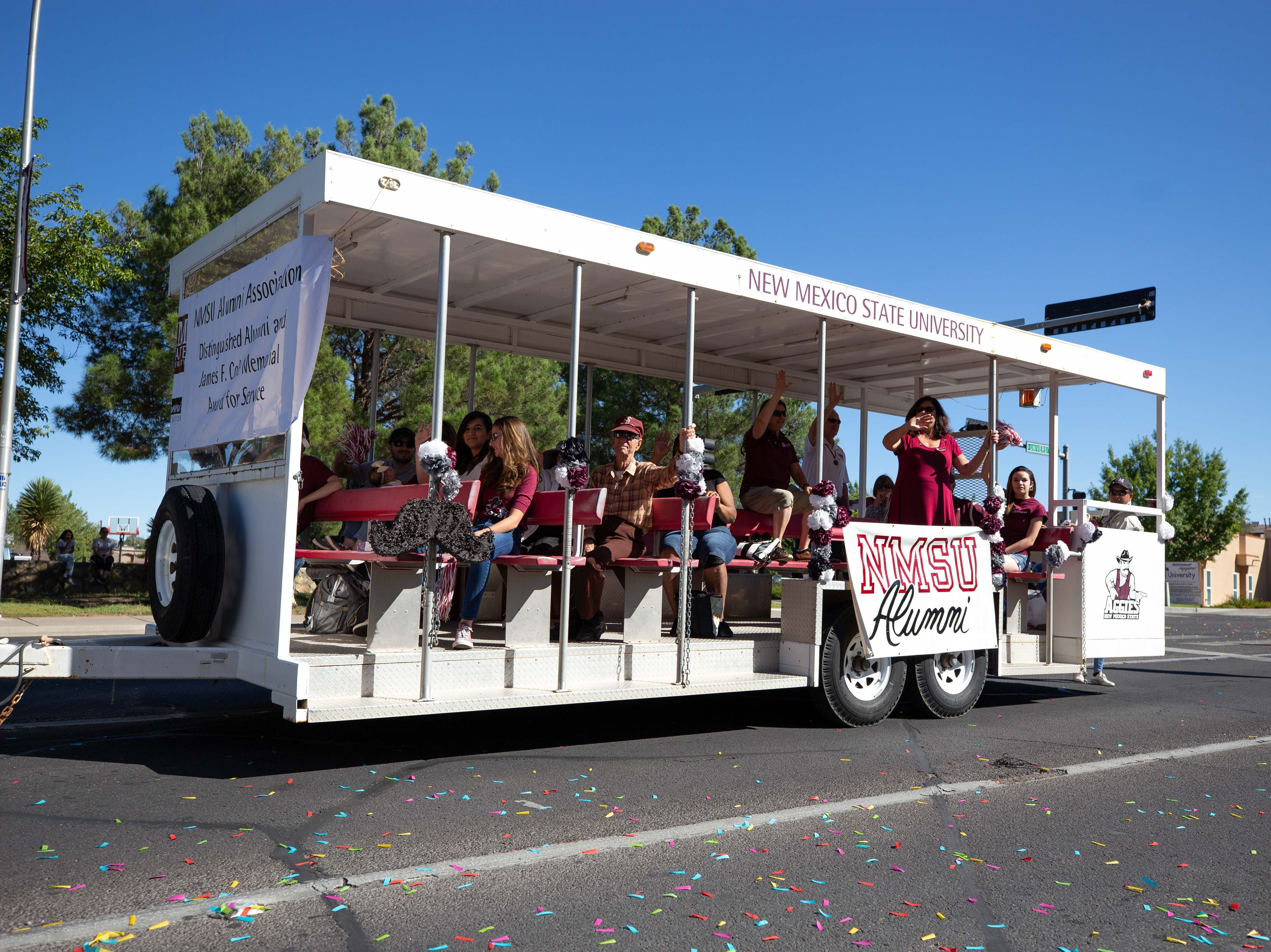 NMSU Alumni Relations and University Advancement trolley with class members from 1958, 1968, 1978, 1988, and 1993 at the NMSU Homecoming Parade on October 6, 2018.