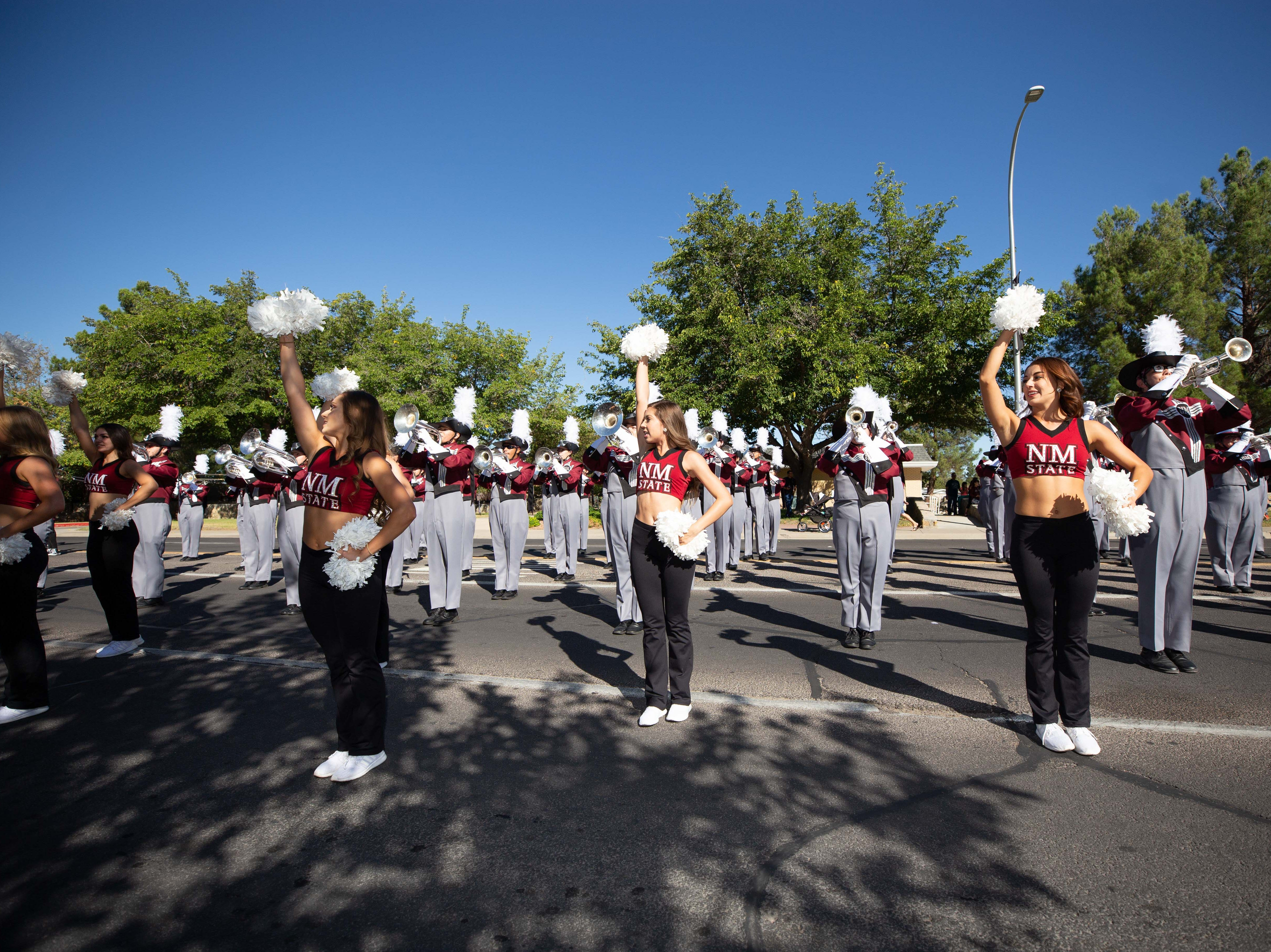The Aggie Pride Band and cheer teamat the NMSU Homecoming Parade on October 6, 2018.