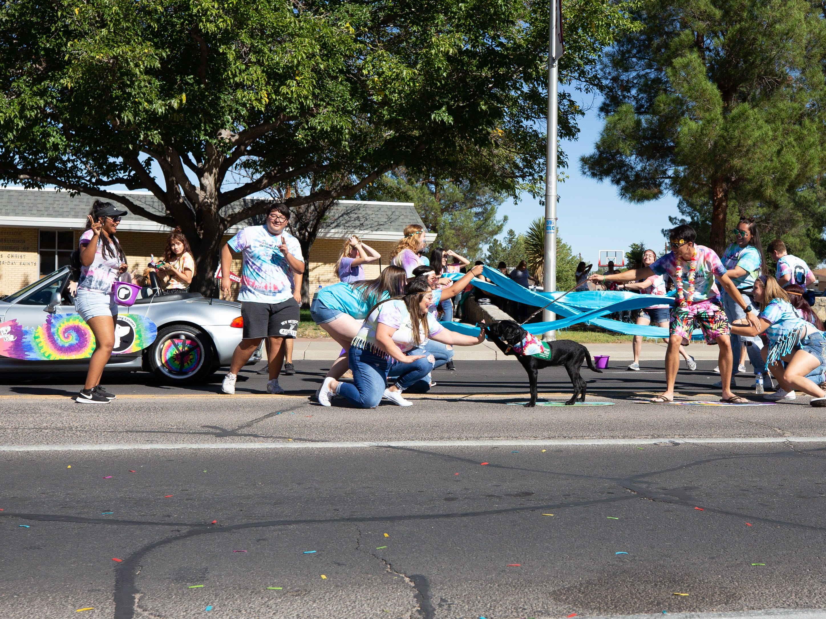 NMSU Raising Canines  entry with the high five giving surfing dog at the NMSU Homecoming Parade on October 6, 2018.
