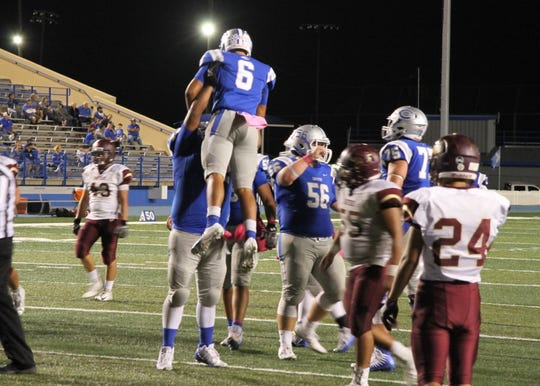 Trey Castaneda is hoisted up by a lineman after scoring his second touchdown of Friday's game against Gadsden.