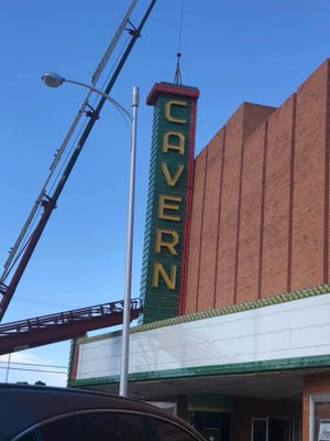 The Cavern Theater marquee sign is placed atop the theater building on Main Street following restoration that allows the marquee sign to lit up again. The restoration is part of the effort to renovate and restore the Cavern Theater by the City of Carlsbad.