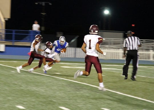 Xander Elizondo pulls down a 33-yard catch during the first quarter of Friday's game against Gadsden.